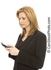 Businesswoman texts on mobile device - Businesswoman texts...