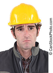A sad construction worker.