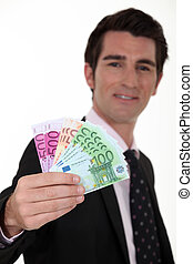 Businessman with a wad of cash