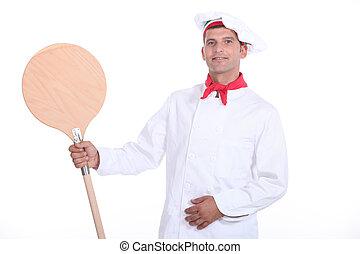 Pizzaiolo showing his shovel