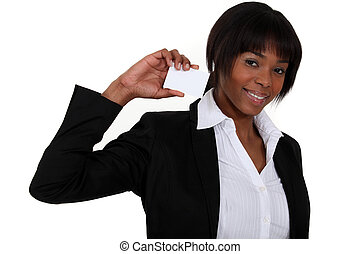 black businesswoman showing business card
