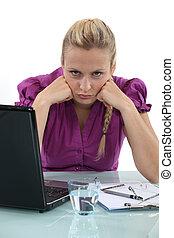 Grumpy blond office worker