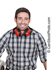 Man wearing protecting ear muffs