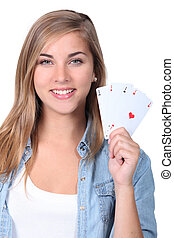 Young girl holding playing cards
