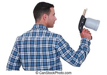 Man holding a spray gun