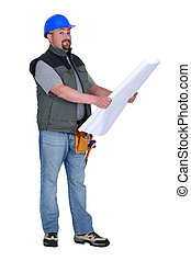 Builder looking at plans