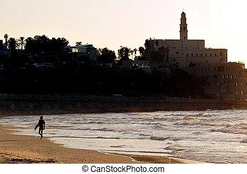 Travel Photos of Israel - Jaffa - Wave surfer against Jaffa...