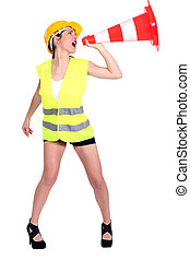 Attractive female construction worker shouting into traffic...