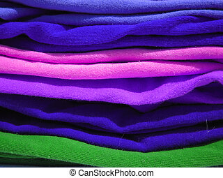 colorful knits - close up of a pile of colorful tshirts...