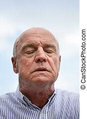 Expressive senior man irritated