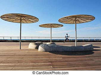 Israel Travel Photos - Tel Aviv - Boy runs at the old Tel...