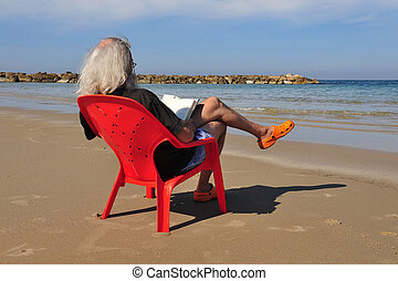 Israel Travel Photos - Tel Aviv - Israeli man sit and read...