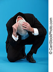 Businessman holding his head in despair