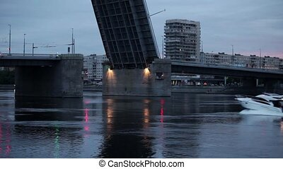 boat near the drawbridge - white motor boat near the...