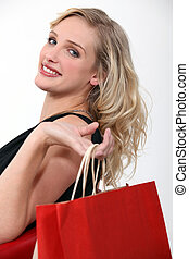 Blond woman returning from shopping trip