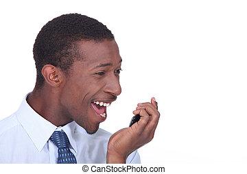 Closeup of a man shouting into his cellphone