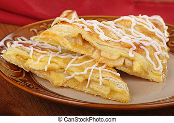 Two Apple Turnovers - Two apple turnover pastries on a plate