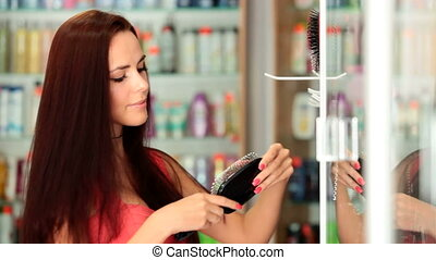 Young Woman Shopping - Young attractive woman choosing...