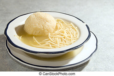 matzoh ball soup - bowl of matzoh matzah ball soup with rice...