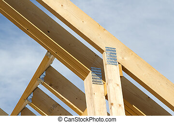 Roof truss joiners, - A wooden roof truss structure section...