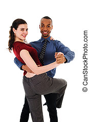 Dancing Couple - young multi ethnic couple beautiful dancing...