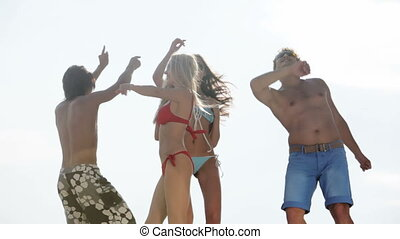 Cool guys and girls spending summer time together dancing