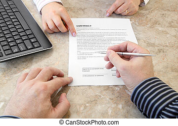 Signing a Contract in the Office