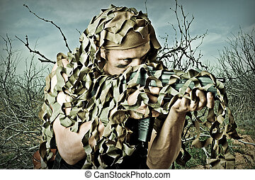Military Camouflaged man with automatic - Military...