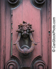 Old doorknocker on pink door - Old doorknocker with the...