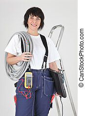 Female electrician ready to work