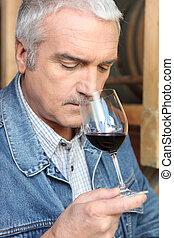 Vintner tasting wine