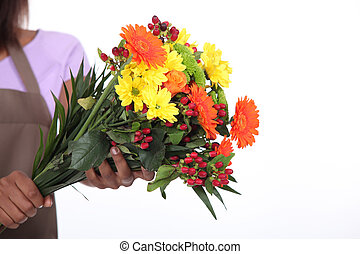 female florist taking a flowers bouquet