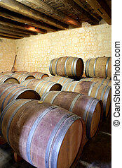 Wine barrels lined up in a cellar