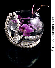 Orchid branch - The branch of an orchid and pearls is in a...
