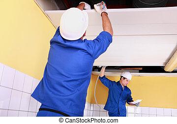 craftsmen wiring a building