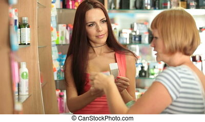 Young Woman Buying Cosmetics