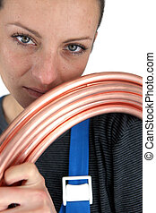 Portrait of woman with copper pipe