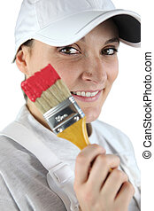 Woman holding a paintbrush