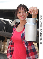 female farmer milking the cows