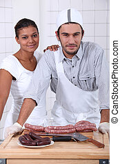 Couple working in a butchers