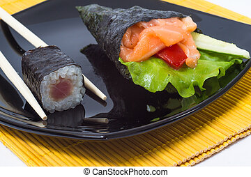 Various kinds of sushi and sashimi Isolated