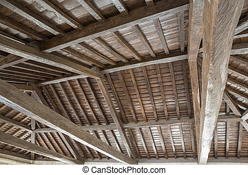 Modern wooden roof with main beam and joist