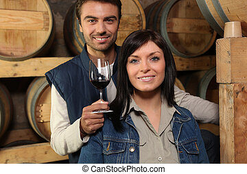 Couple of winemakers in the winery