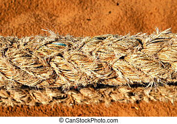 thick synthetic rope and sea sand on background - Closeup of...