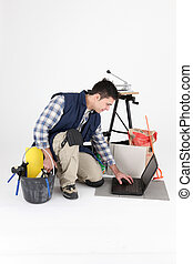 Tiler with equipment, studio shot