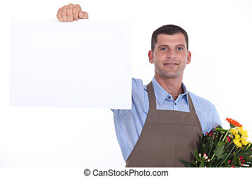 Florist holding up a blank sign