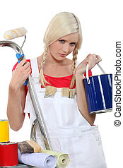 serious female house painter