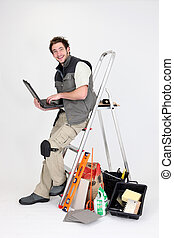 Tiler with equipment on white background