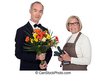 Man getting flowers from florist