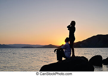 Young couple admiring the sunset